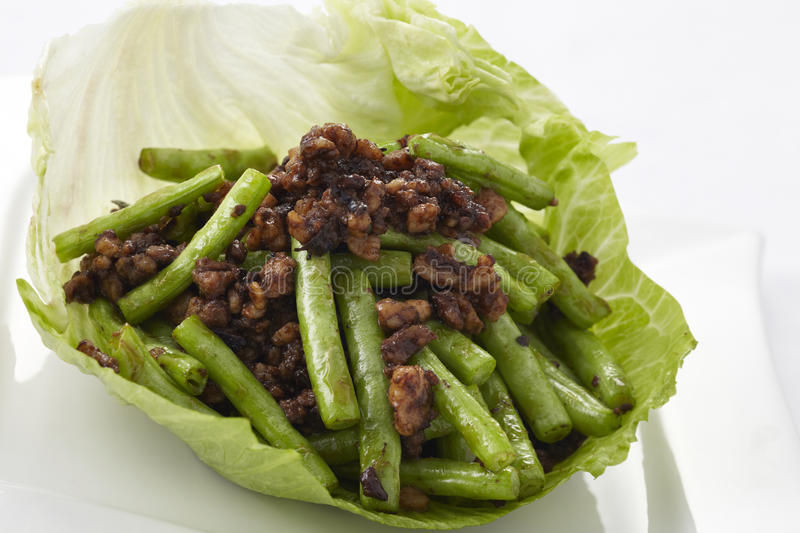 Stir-fried green bean with minced pork and Chinese black olives royalty free stock images