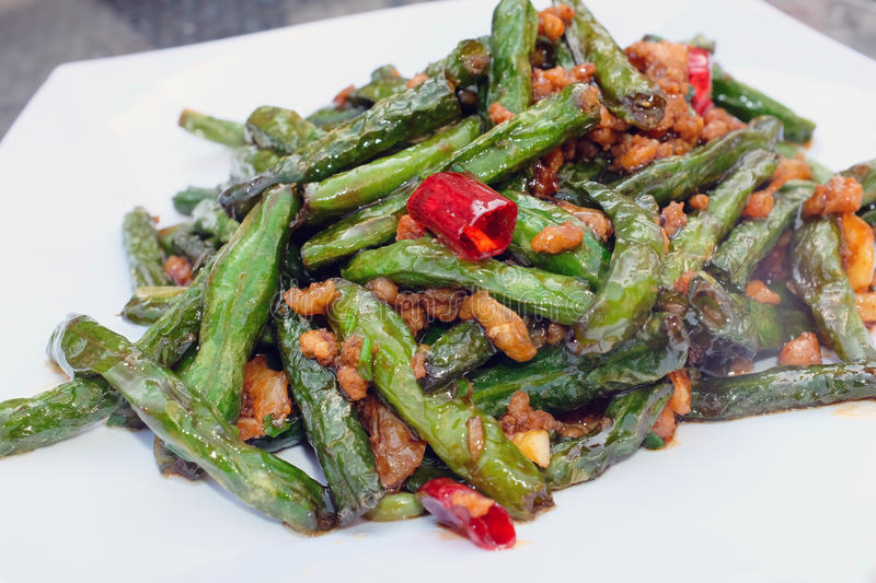 Stir fried green beans. Chinese food: stir fired green beans with pork and red peppers royalty free stock image
