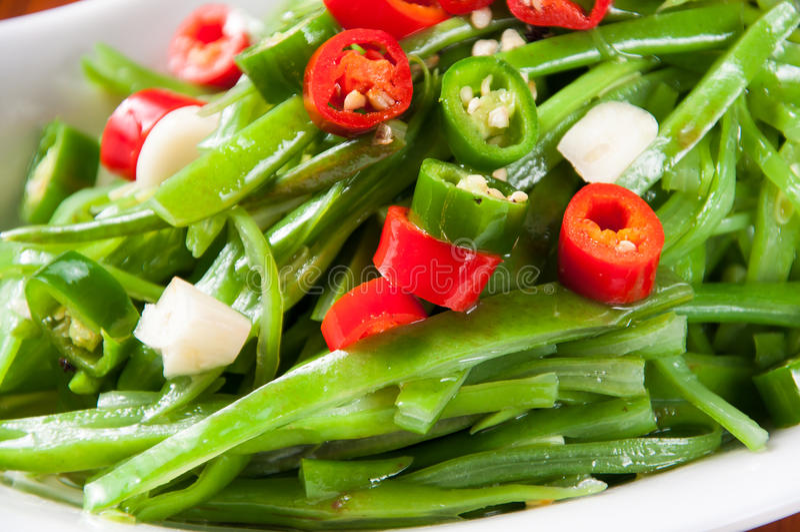 Stir-fried green beans. Vegetables royalty free stock image