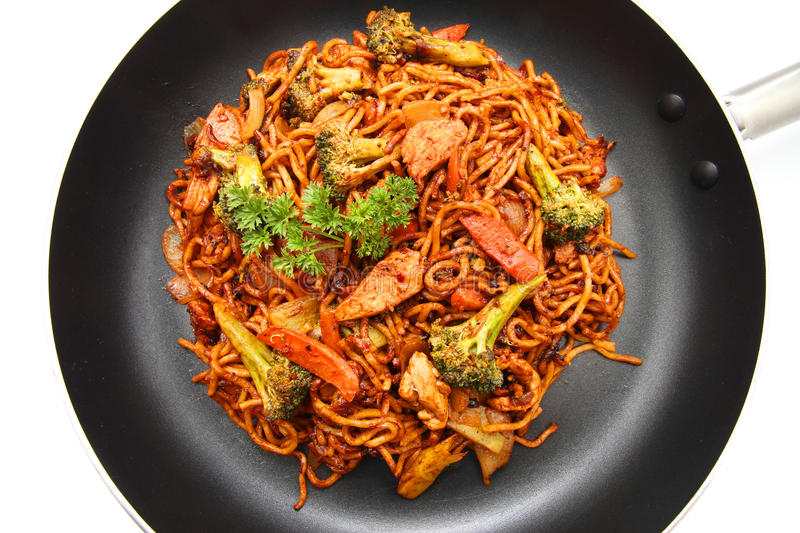 Stir fried Hokkien Noodle. In a fying pan on white background stock photo