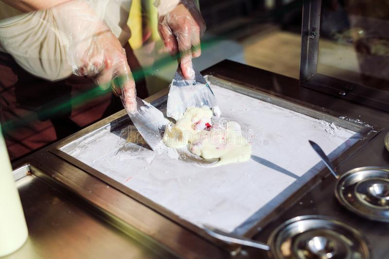 Stir-fried ice cream rolls at freeze pan. Organic, natural rolled ice cream, hand made dessert. Stir-fried ice cream rolls at freeze pan. Organic, natural stock images