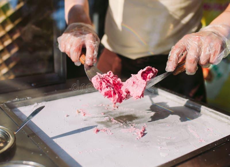 Stir-fried ice cream rolls at freeze pan. Organic, natural rolled ice cream, hand made dessert.  stock photo