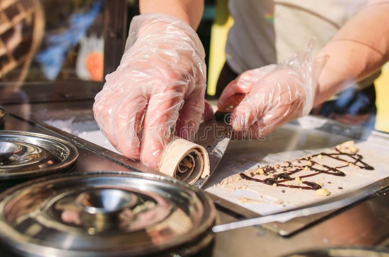 Stir-fried ice cream rolls at freeze pan. Organic, natural rolled ice cream, hand made dessert.  stock photography
