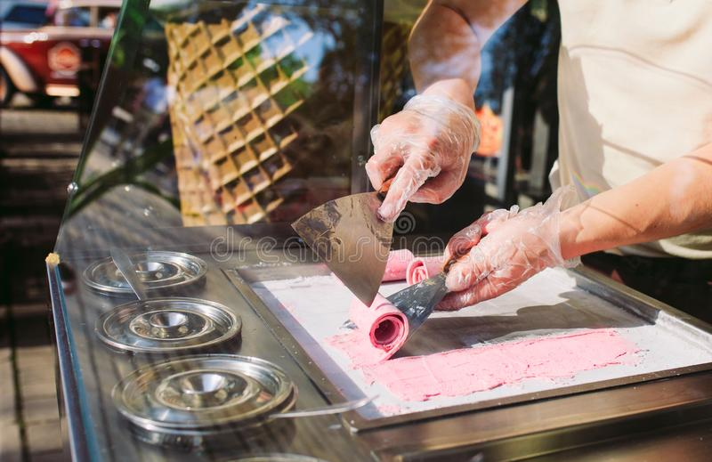 Stir-fried ice cream rolls at freeze pan. Organic, natural rolled ice cream, hand made dessert.  stock photos