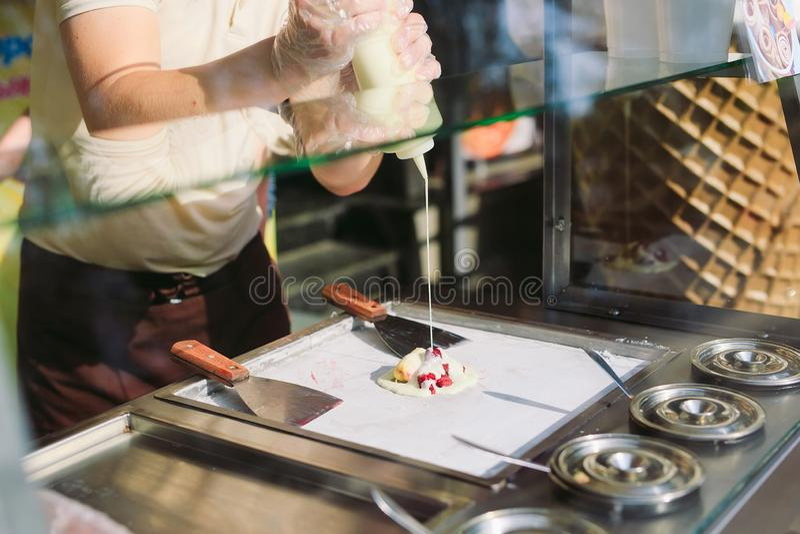Stir-fried ice cream rolls at freeze pan. Organic, natural rolled ice cream, hand made dessert.  stock image