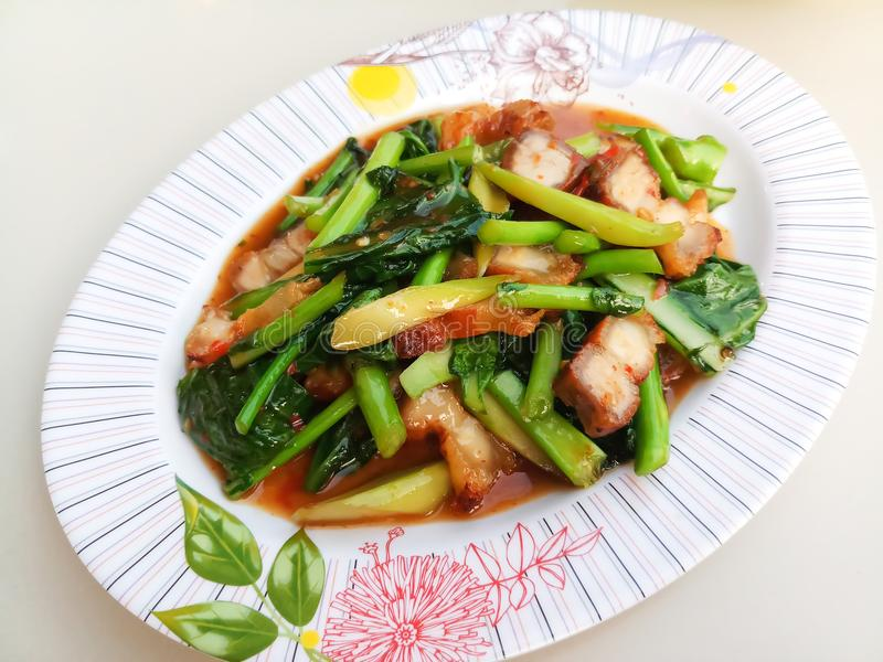 Stir fried kale with crispy pork. / Thai Food is delicious stock images