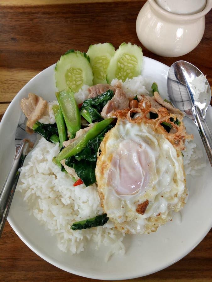 Stir Fried Kale with Pork Egg. Thai food royalty free stock images