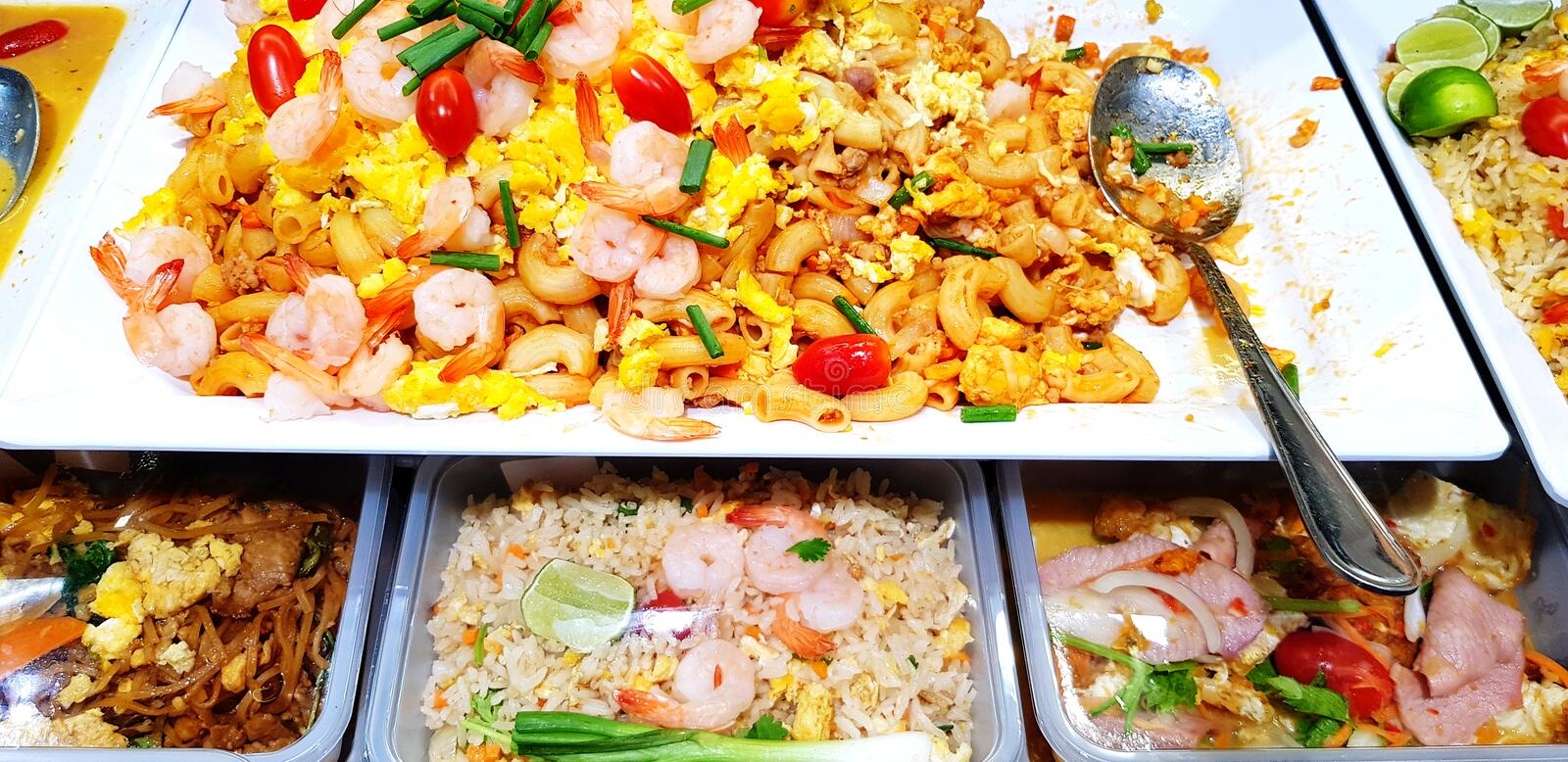 Stir fried macaroni with prawn and Fried rice with shrimp on white tray with spoon for sale stock images