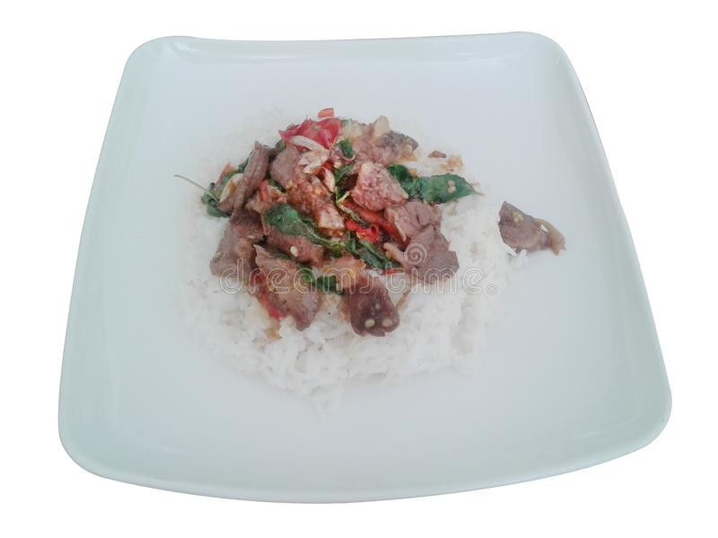 Stir-fried with minced pork and basil on white plate Ka Prao Moo. on white background. photo royalty free illustration