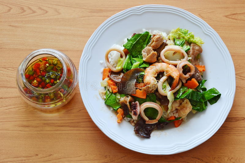 Stir fried mixed vegetable with seafood and chili fish sauce. Cup royalty free stock photos