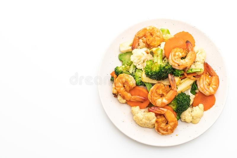 Stir-fried mixed vegetable with shrimps. Isolated on white background stock photos