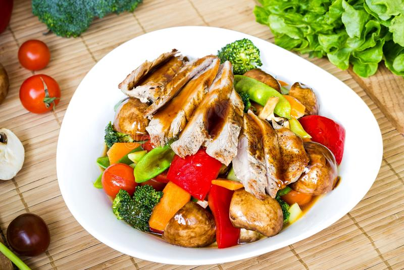 Stir fried mixed vegetables with meat. Topping with vegetable sauce royalty free stock photo