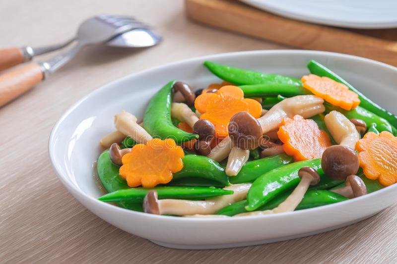 Stir fried mixed vegetables on plate, Vegetarian food royalty free stock images