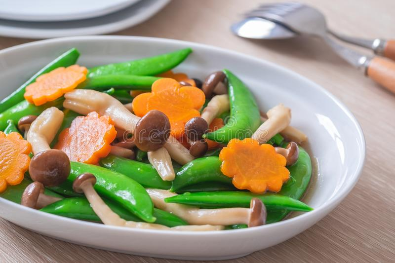 Stir fried mixed vegetables on plate, Vegetarian food royalty free stock photos