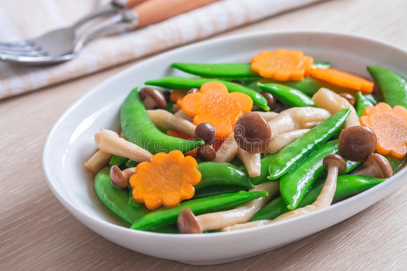 Stir fried mixed vegetables on plate, Vegetarian food stock photography