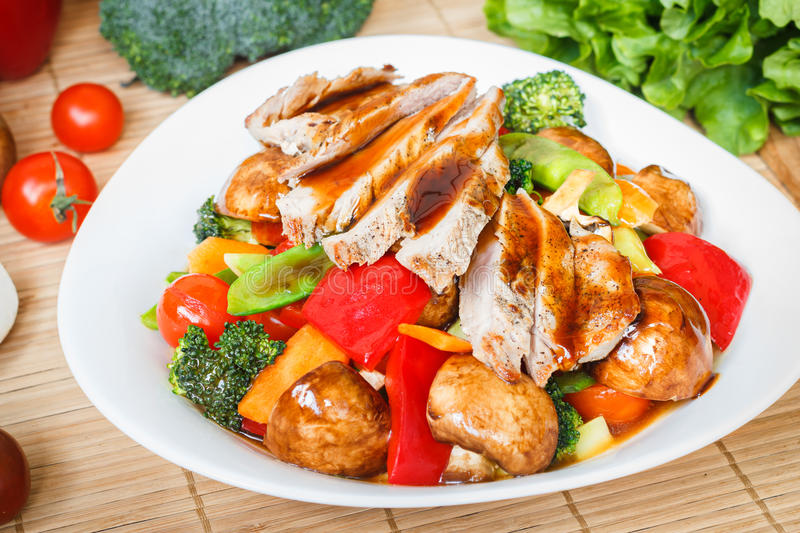 Stir fried mixed veggies and grilled meat stock photos