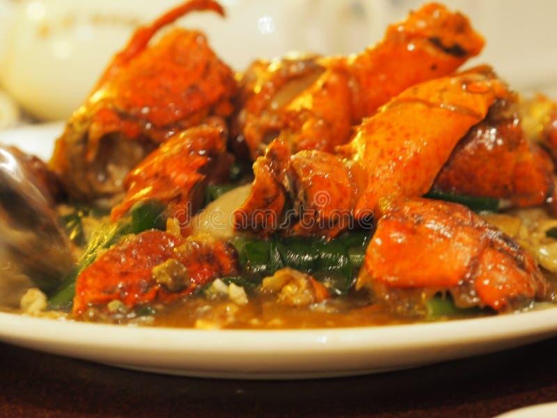 Stir-fried Mjuk-besköt humret i curry royaltyfri foto