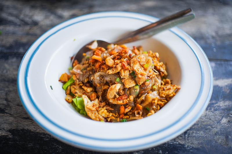 Stir fried noodle with chicken recipe. Thai food royalty free stock photos