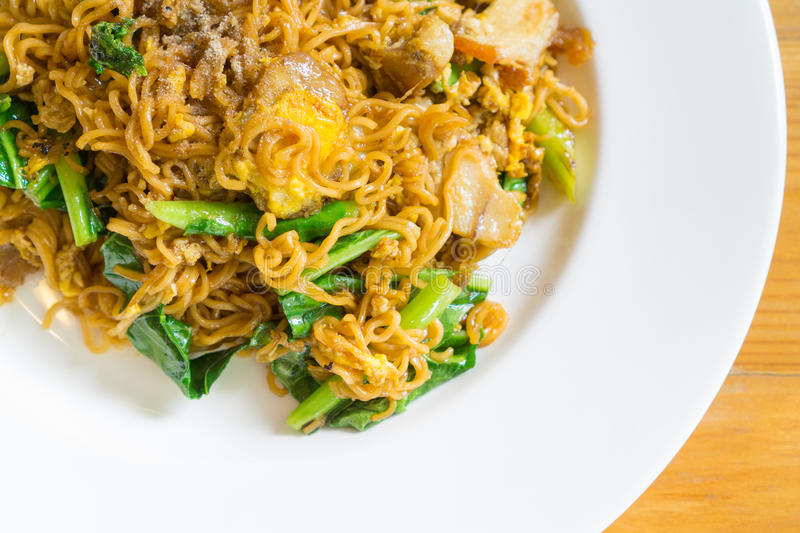 Stir fried noodle with minced pork. And vegetable, selective focus stock photo