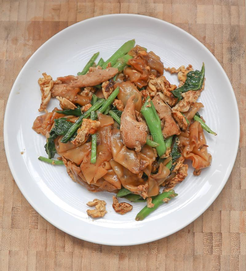 Stir fried noodle with pork and kale. Thai noodle royalty free stock images