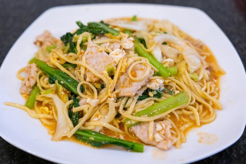Stir fried noodle with pork Khmer style royalty free stock image