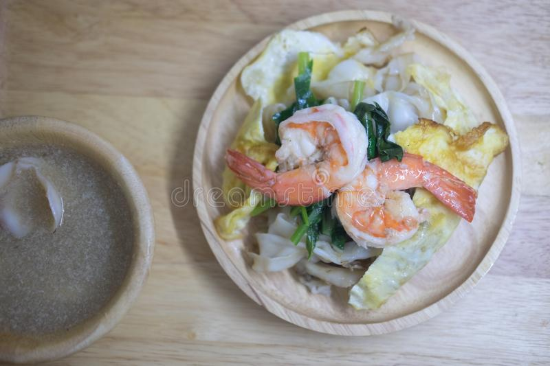 Stir-fried noodle with seafood and kale in gravy sauce stock image