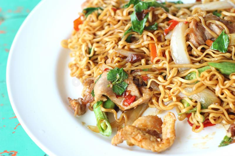 Stir fried noodle spicy in pork stock photography