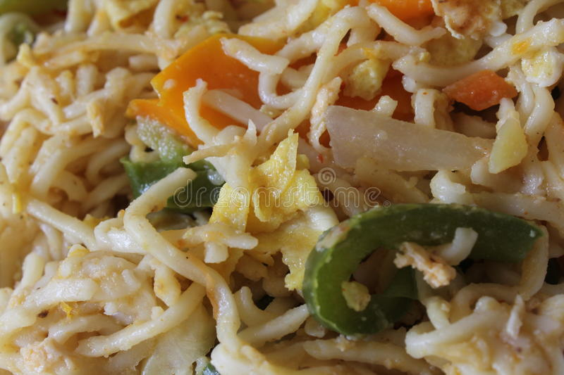 Stir fried noodle. With vegetables, egg and chicken royalty free stock photo