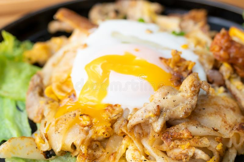 Stir fried noodles with chicken and fried egg Thai food royalty free stock photo