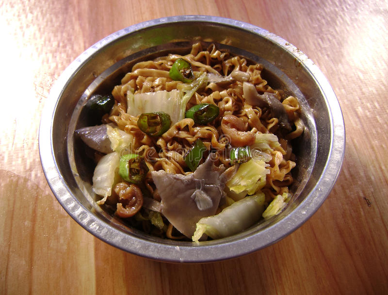 Stir-fried noodles with mushrooms royalty free stock photo