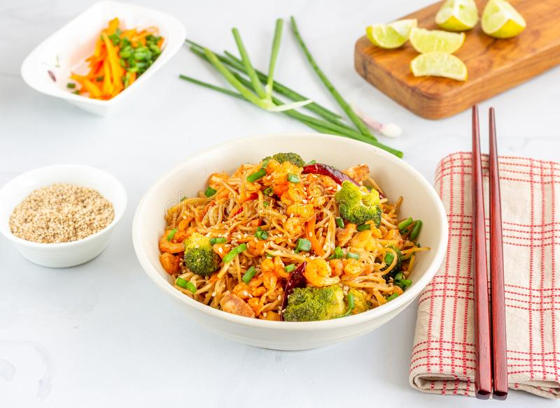 Stir-Fried Noodles with Vegetables, Chicken and Shrimp. American-Chinese Cuisine Style Stir-Fried Noodles with Vegetables, Chicken and Shrimp. Noodle Bowl with stock photo