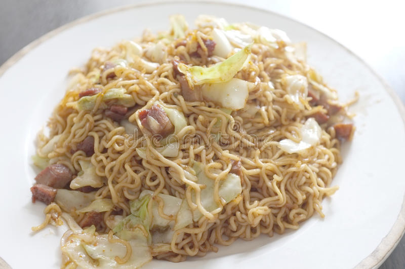 Stir fried oriental style instant noodle with mixed vegetable stock images