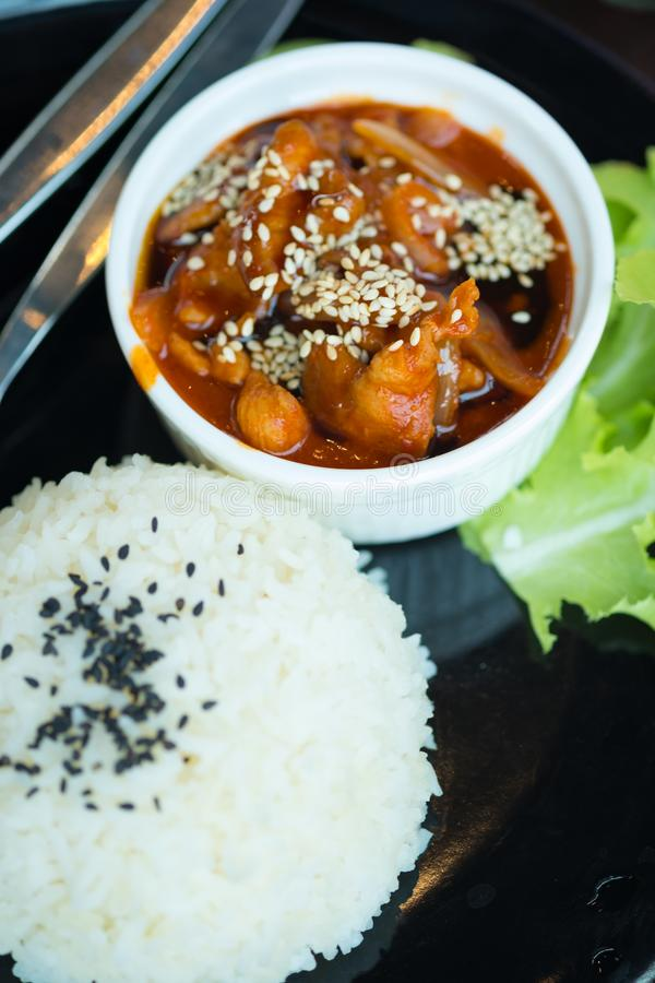 Stir fried pork with sauce and sesame served with rice royalty free stock image