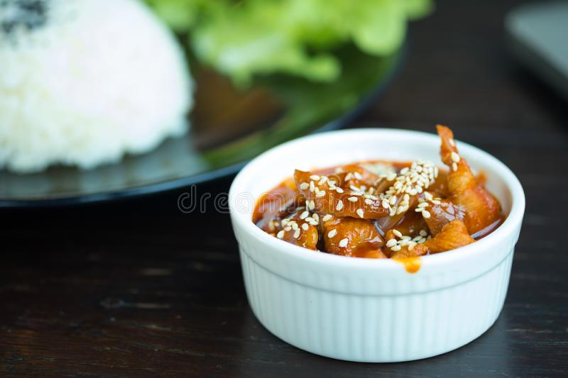 Stir fried pork with sauce and sesame in white bowl stock photos
