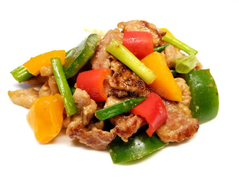 Stir Fried Pork 3. Stir fried pork with scallions and peppers on a white background stock photography