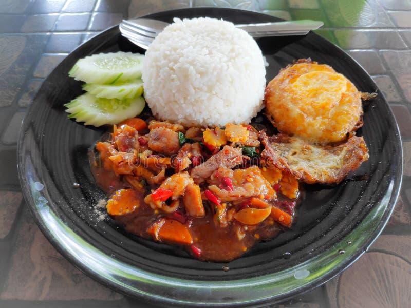 Stir fried pork stream rice with Crispy fried egg breakfast. Stir fried pork stream rice with Crispy fried egg royalty free stock photos