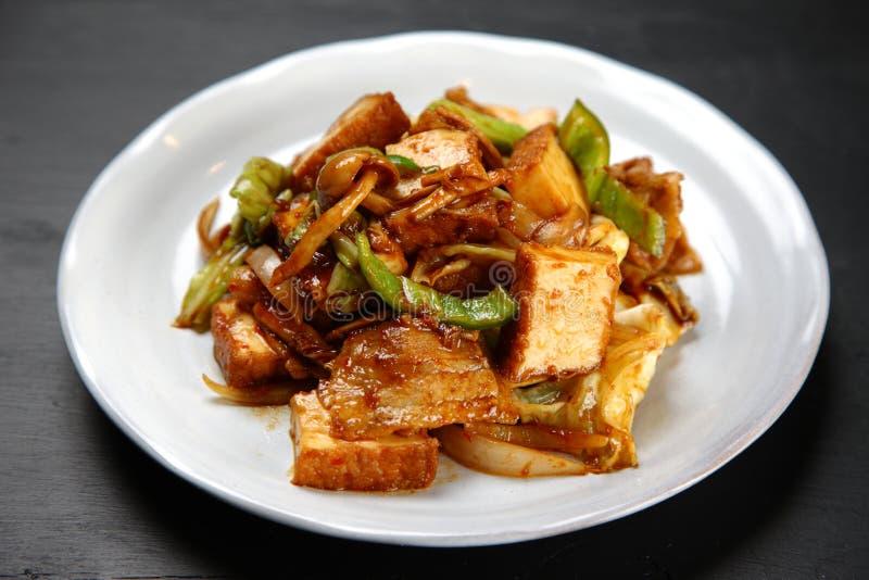 Stir-fried pork and thick fried tofu. Studio shot of Stir-fried pork and thick fried tofu on a dining table stock image