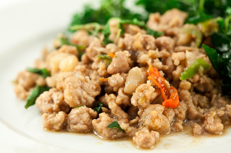 Stir fried pork whit basil royalty free stock photo