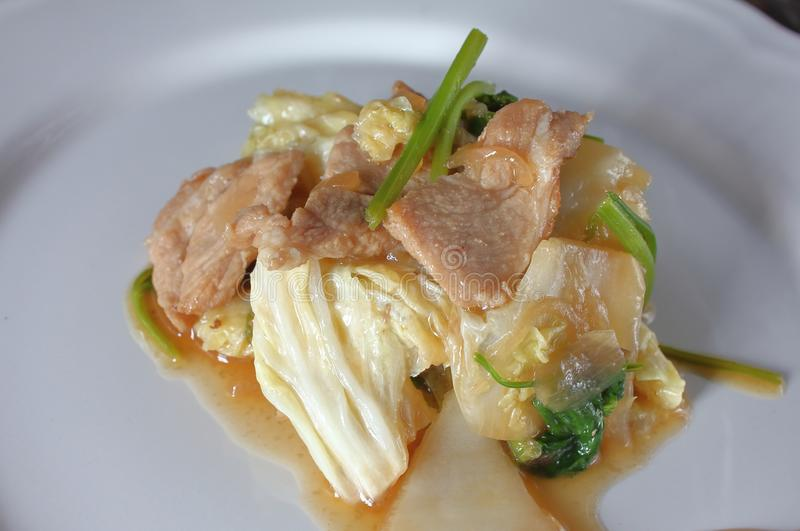 Stir fried pork with white cabbage in thaifood. Stir fried pork with cabbage in thaifood stock photo
