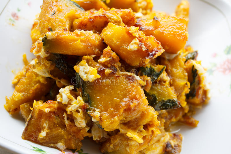 Stir-fried pumpkin with egg. On dish royalty free stock photo