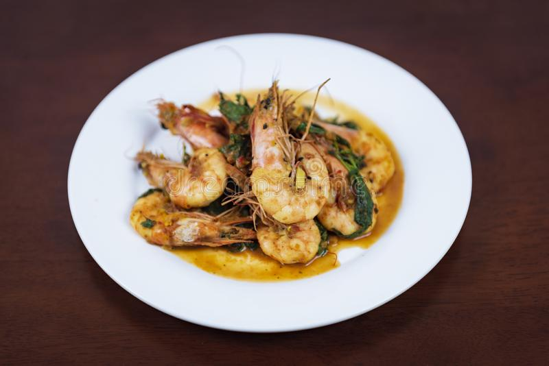 Stir fried red curry with shrimp, Thai food. Stir fried red curry with shrimp Thai food on a wooden background stock images