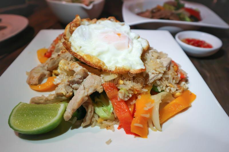 Stir-fried ric with fried egg. Thai food royalty free stock photo