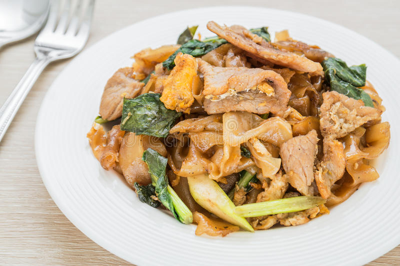 Stir fried rice noodle with pork (Pad See Eiw). Stir fried rice noodle with pork on plate (Pad See Eiw) stock photo