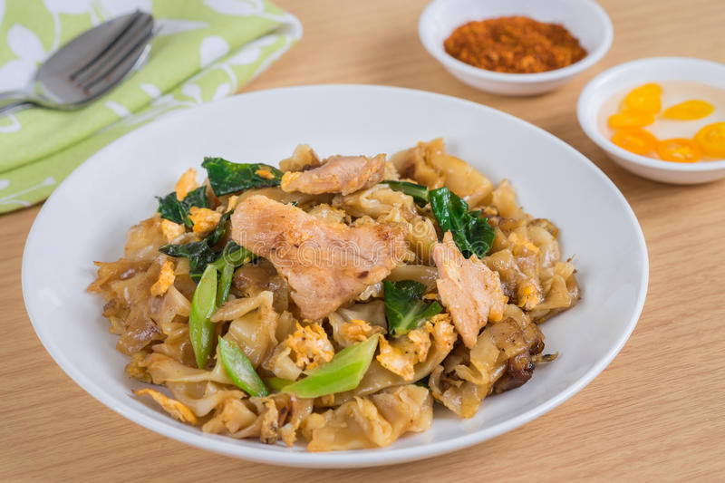 Stir fried rice noodle with pork on plate royalty free stock image