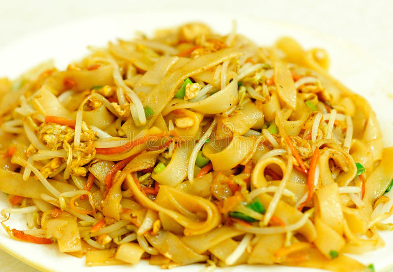 Stir fried rice noodles. With egg and vegetables royalty free stock images