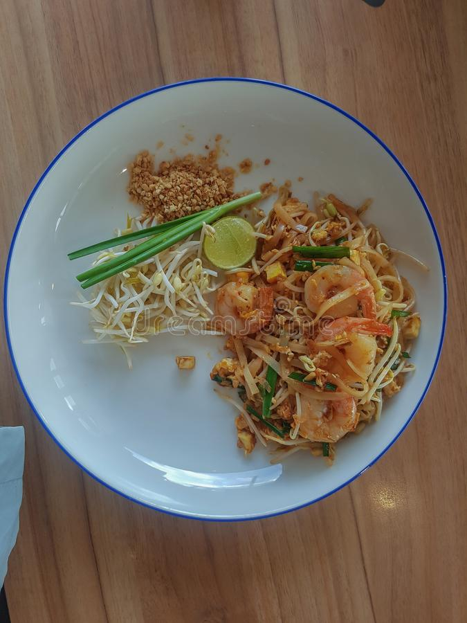 Stir-fried rice noodles Pad -Thai. Stir fry noodles with shrimp in Pad Thai,Thai style food royalty free stock photo