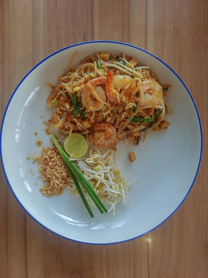 Stir-fried rice noodles Pad -Thai. Stir fry noodles with shrimp in Pad Thai,Thai style food royalty free stock images