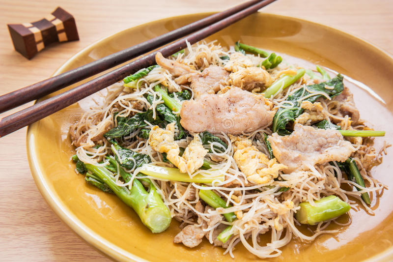 Stir fried rice noodles with pork (Pad See Eiw). Stir fried rice noodles with pork on dish (Pad See Eiw) royalty free stock image