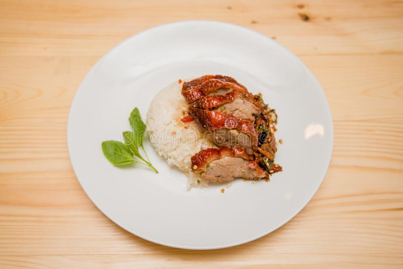 Stir-fried roasted duck and basil and fried egg with rice, Thai. Food royalty free stock photo