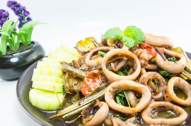Stir-fried salted egg with squid on dish, traditional Thai food.  royalty free stock images